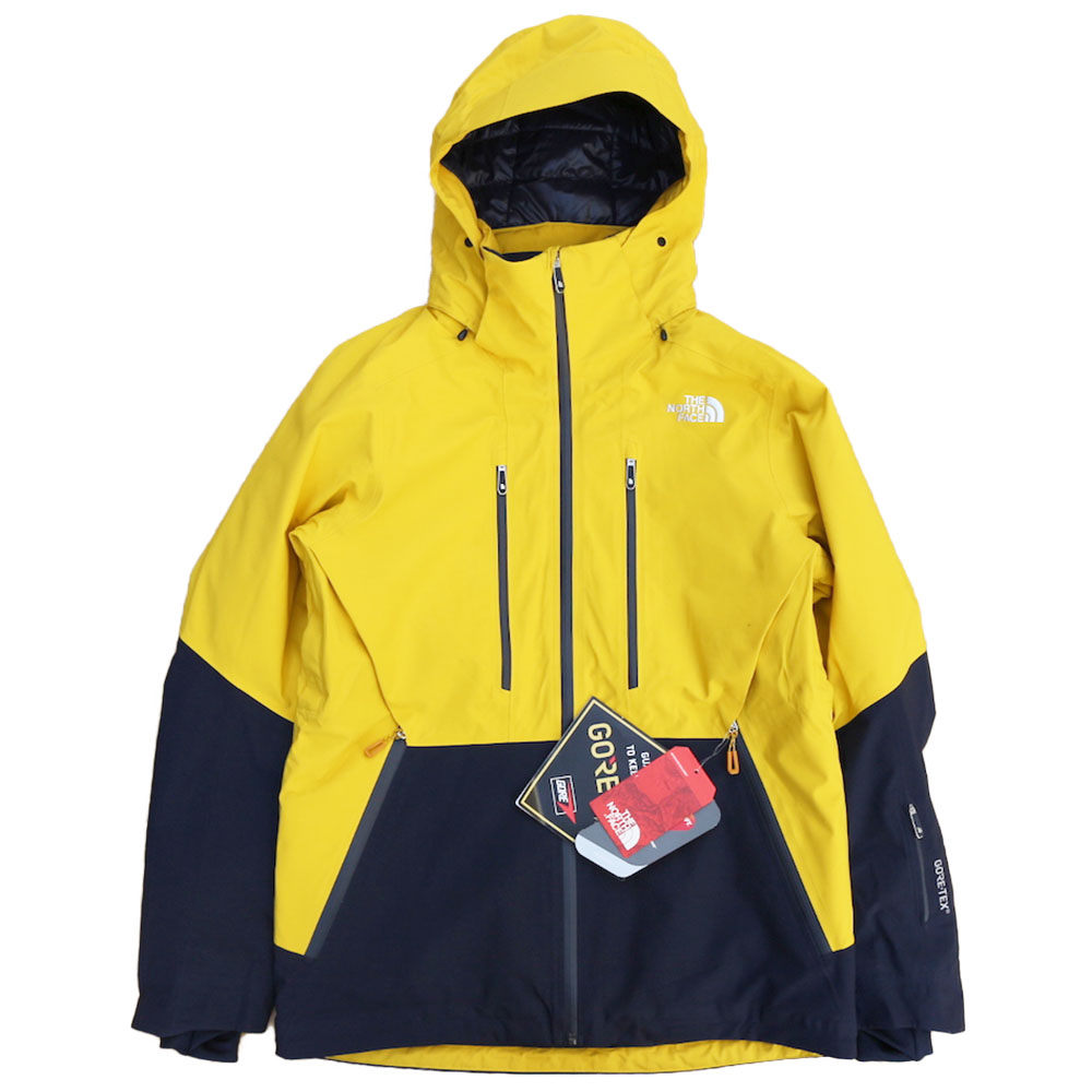 719ef6a20a7e THE NORTH FACE ANONYM JACKET  LEOPARD YELLOW URBAN NAVY