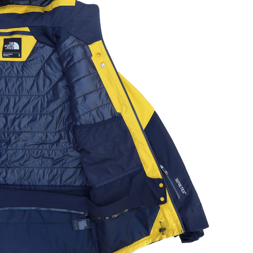 c684fe27f2c0 THE NORTH FACE ANONYM JACKET  LEOPARD YELLOW URBAN NAVY
